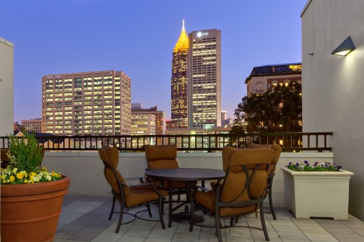 Rooftop Apartment Terrace with Atlanta Skyline at Night